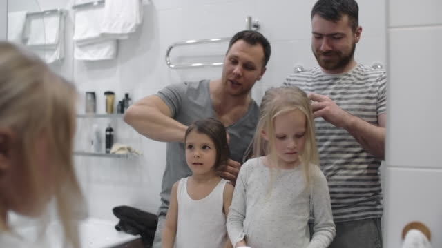 Same-sex couple doing daughters' hair video