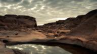 SamPhanBok Rocks and Drifting Clouds at Dawn Sliding Motion Time-lapse video