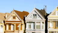 San Francisco row of painted Victorian houses 4k video left pan video