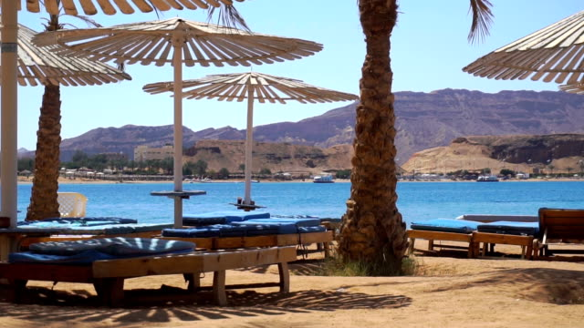 sand beach with views of the sea and mountains video