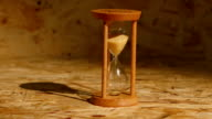 Sand falls quickly through an hourglass video