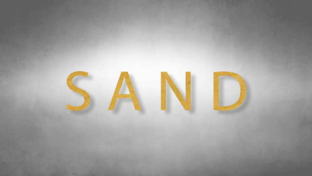 Sand headband. Text from sand. With black background video