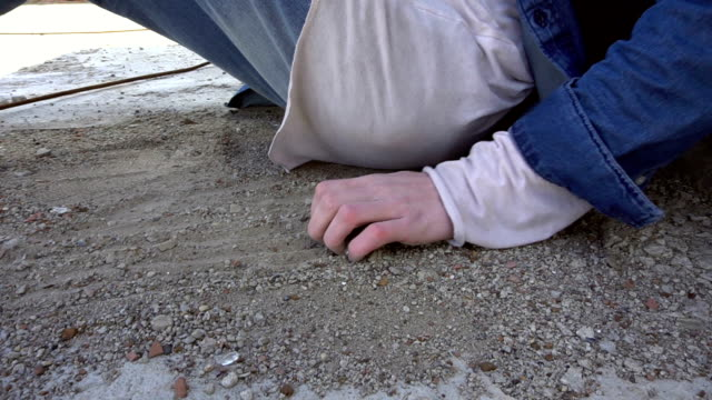 Sand in the hands of men video