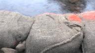 Sandbag Wall Flooding dolly shot video