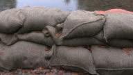 Sandbag Wall Heavy Rain dolly shot video