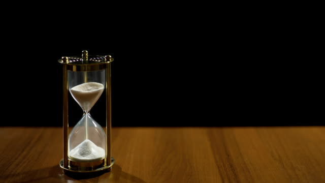 Sandglass measuring time by sand flow, life passing quickly, time management video