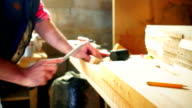 Sanding a piece of wood. video
