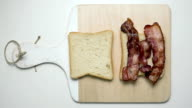 Sandwich with bacon and sauce, time-lapse video