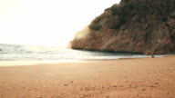 Sandy beach and sea scene with sunset video