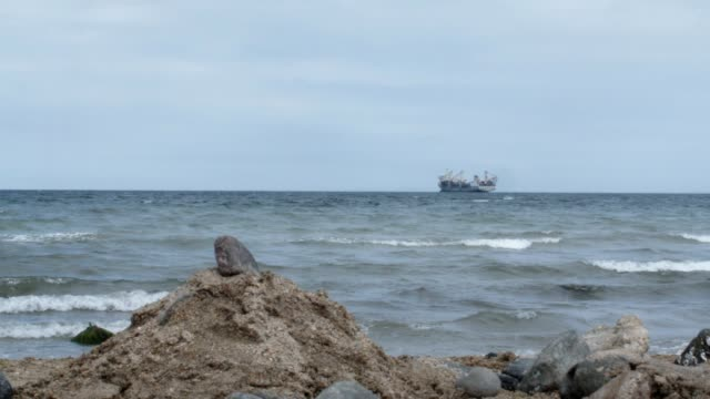 Sandy Beach At The Seacoast With A Ship In Background. video