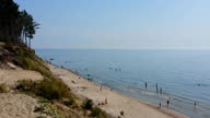 Sandy beach with people, Baltic sea video