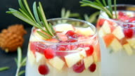 Sangria with cranberries, apples and rosemary video