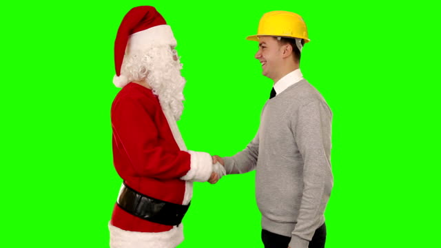 Santa Claus and Young Architect shaking hands, Green Screen video