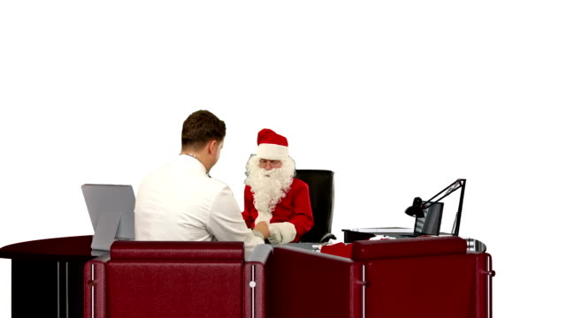 Santa Claus at Doctor, measuring blood pressure, against white video