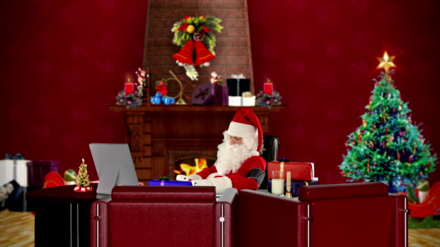 Santa Claus at work checking blood pressure, Christmas decorated office video