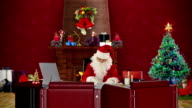 Santa Claus at work, office with Christmas decorations video