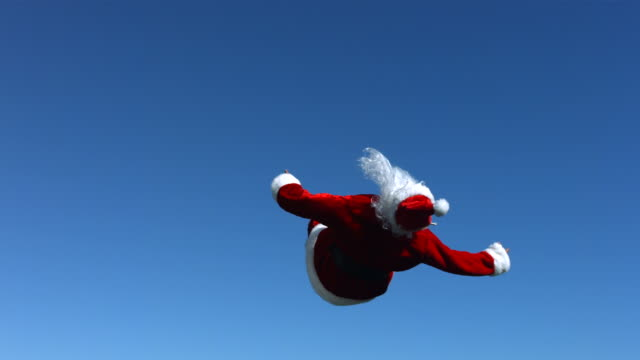 Santa Claus does a flip in the air, slow motion video