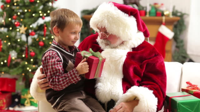 Santa Claus gives Christmas gift to young boy video
