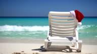 Santa Claus Hat on sunbed near  tropical calm beach video