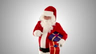 Santa Claus holding presents, against white video