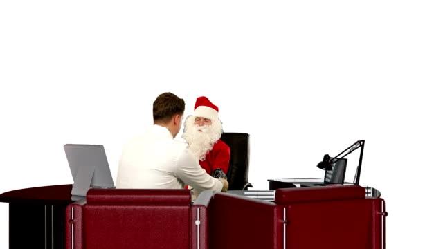 Santa Claus is sick, Doctor measuring blood pressure, against white video