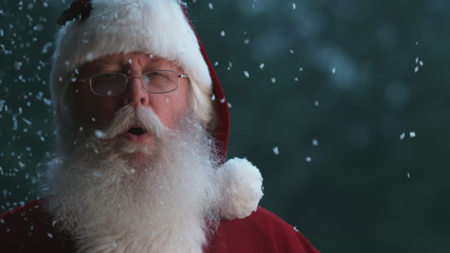 Santa Claus laughing with snow in slow motion video