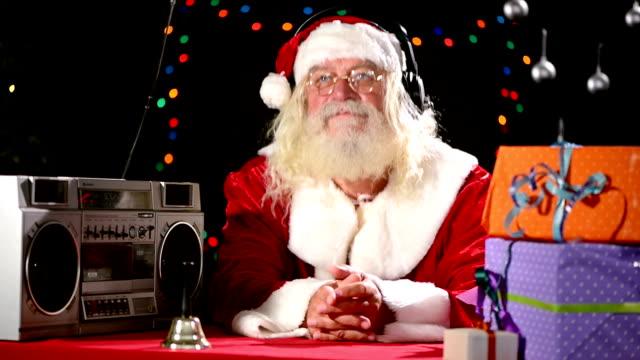 Santa Claus listening music video