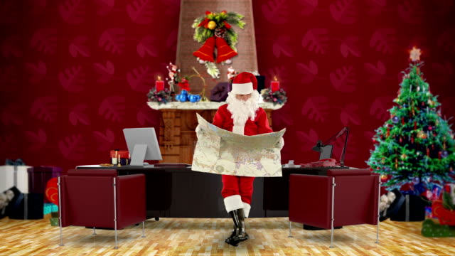 Santa Claus reading a map in his modern Christmas Office video