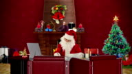 Santa Claus reading letters, office with Christmas decorations video