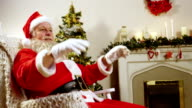 Santa claus relaxing with hands behind head video