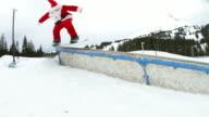 Santa Claus shredding in snowboard park video