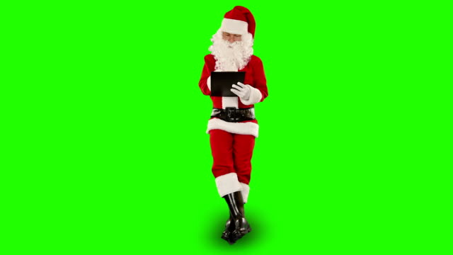 Santa Claus taking notes on a clipboard, Green Screen video