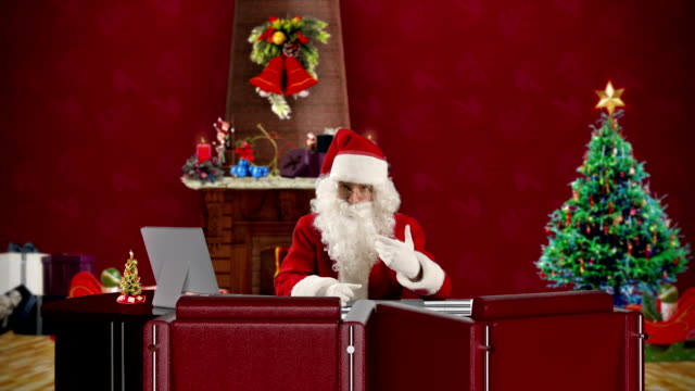 Santa Claus talking in a Christmas Room video