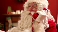 Santa Claus talking on telephone video