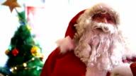 Santa Claus talking to camera and gesturing. video