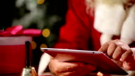 Santa Claus use tablet video