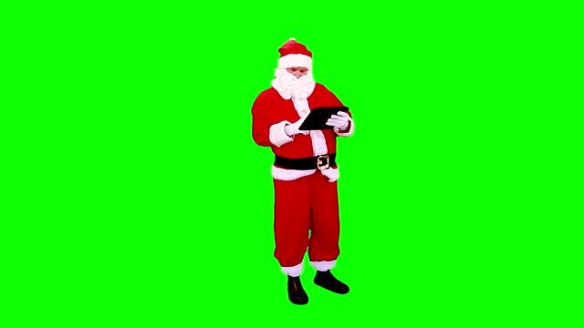 Santa Claus using a Tablet. Green Screen. video