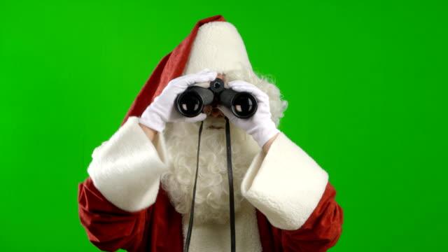 Santa Claus with Binoculars Looking Around video