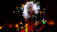 Santa Claus with christmas lights on head, turns, blinking, glasses, motion, christmas decoration video