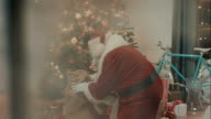 Santa Clause brings presents to familys house video