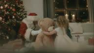 Santa Clause brings presents to kids video