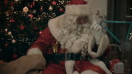 Santa Clause brings presents to kids video