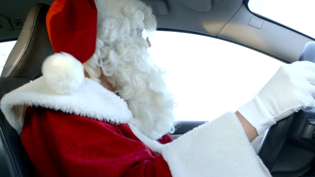 Santa Driving - Santa Claus on a bumpy forest road. video