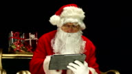 Santa / Father Christmas in sleigh on Digital Tablet video