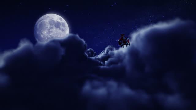Santa flying over full moon. video