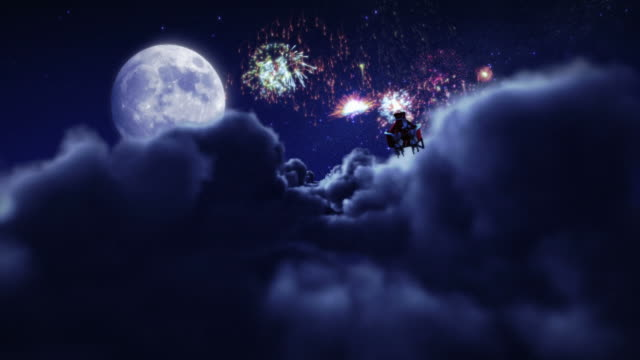 Santa flying with fireworks over full moon. video