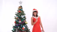 Santa Girl playing with toy and snowflake video
