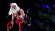 Santa in a gym training biceps 006 video