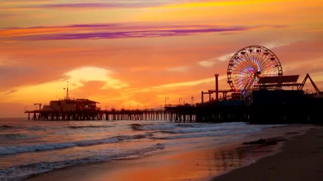 Santa Monica California sunset on Pier Ferris wheel and reflection on beach video