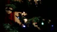 Santa socks on new year tree background video